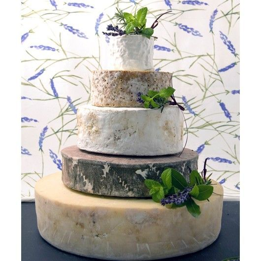The cake of cheese!   back 40 artisan cheese full wheel of madawaska, full wheel of BONNECHERE, half a wheel HIGHLAND BLUE cut horizontally, plus a pound and a half other cheese, one approx 7.5x 4 cm the other approx 4x4 serves 65 add 450g other cheese to plates for 70 guests, 1/4 bunch of grapes per table