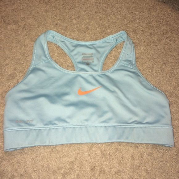 Nike sports bra Nike dri-fit baby blue sports bra with coral Nike check. Perfect condition Nike Other