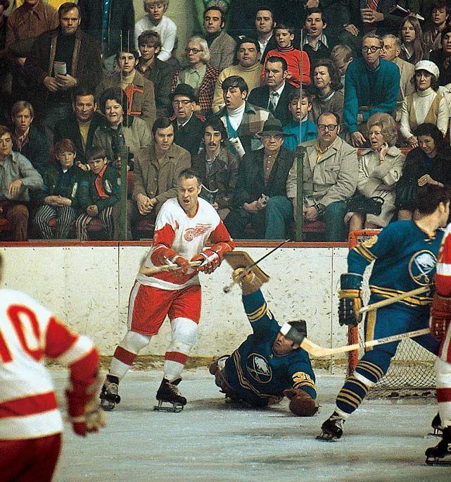 gordie howe is poised to score against buffalo sabres goalie joe daley in january 1971