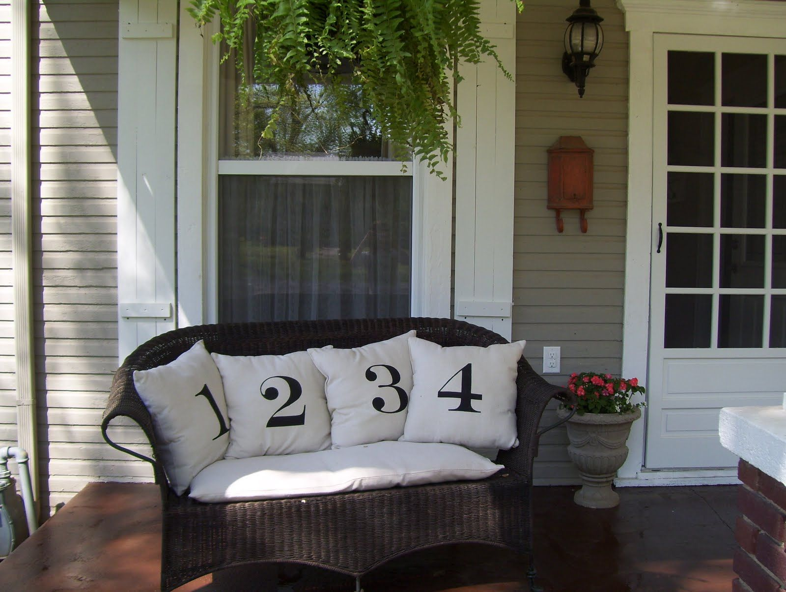 After seeing these numbered pillows in a Pottery Barn catalog, I decided to make them myself by printing the numbers off the computer, creating a stencil with freezer paper and painting the numbers on the fabric. Fun and free! #sideporch