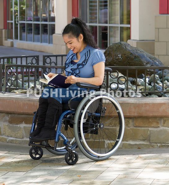 4591f00b91d4b Young woman using a wheelchair shopping with family   Beautiful ...