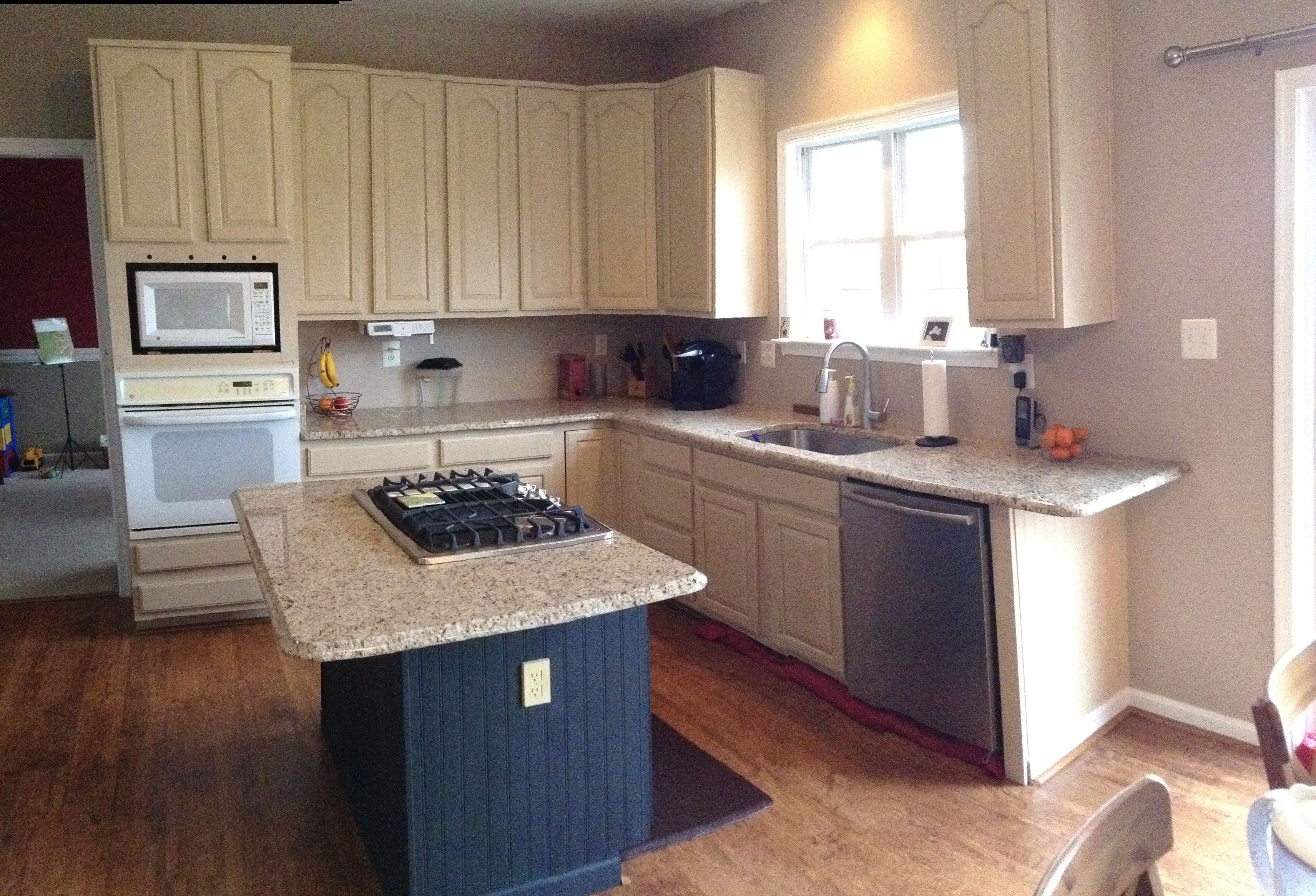 These builder-grade oak cabinets were given a new look to ...