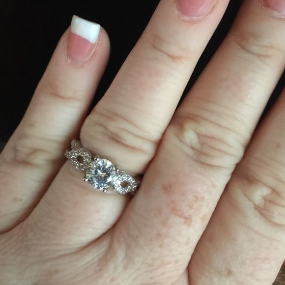 1kt CZ engagement ring Really pretty 1kt, AAA quality, Swiss CZ, engagement ring. Set in 925 silver (S925 stamped on band) no trades or lowball offers, please. Jewelry Rings