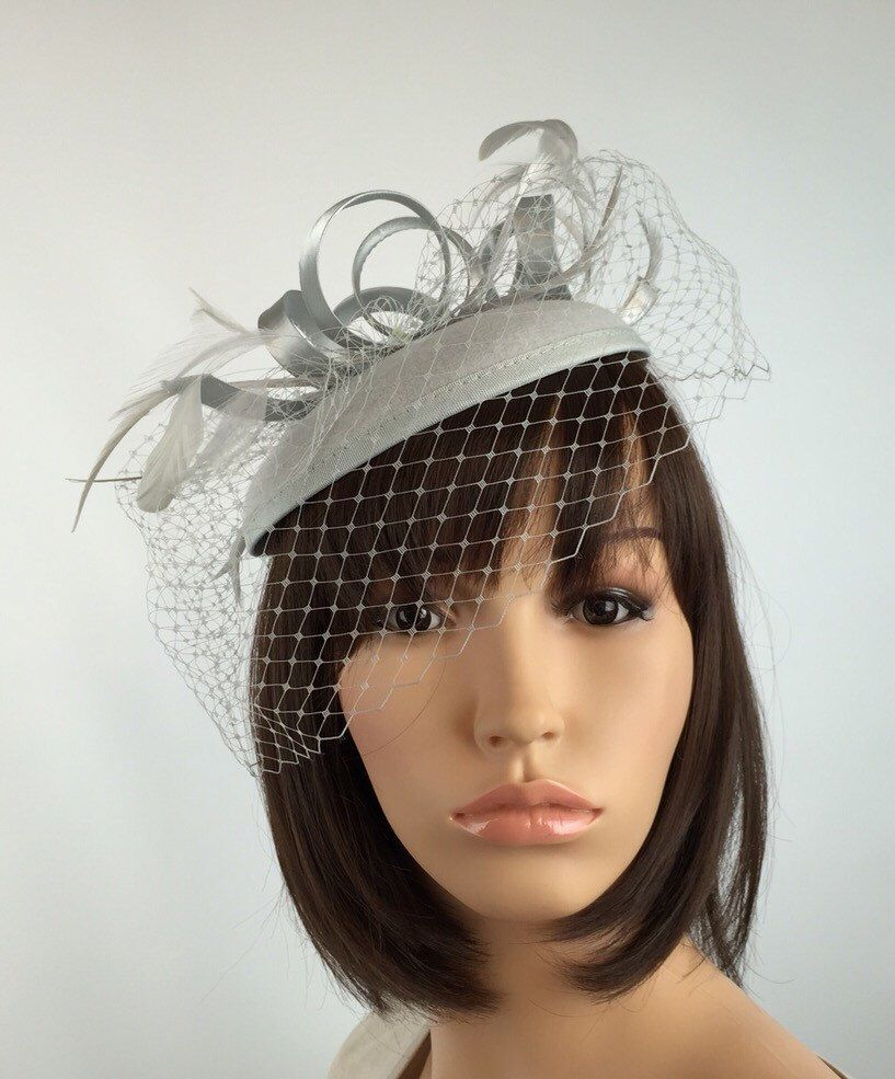 36a12996 Pale Silver fascinator hat Grey Fascinator Wedding Hatinator Pillbox Hat  and net veil. Races, Weddings, Bride, Occasion, Parties in 2019 | hats |  Grey ...