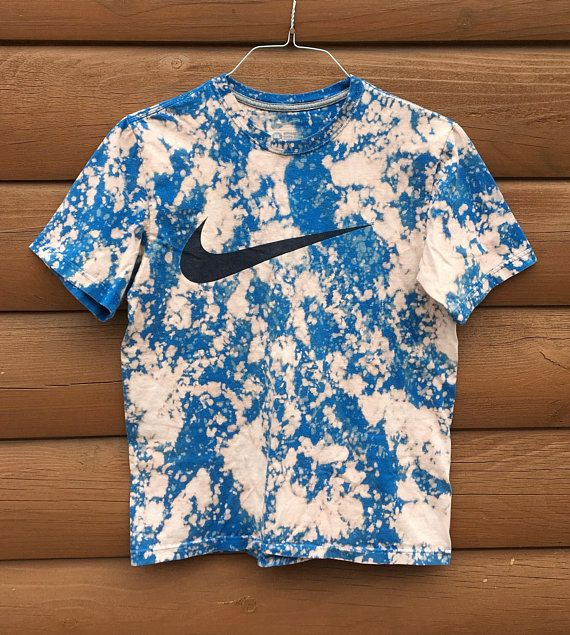 15c204204ea9 Hand Bleached Blue Nike Swoosh Shirt Size medium Graphic is in great  condition! Could be for guys or girls Please see last photo, hem lays a  little funny ...