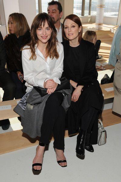 Dakota Johnson Photos - Actresses Dakota Johnson (L) and Jullianne Moore attend the Boss Womens fashion show during…