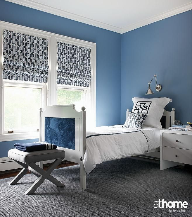 Blue Kid S Bedroom Features Walls Painted Deep Blue Lined With A
