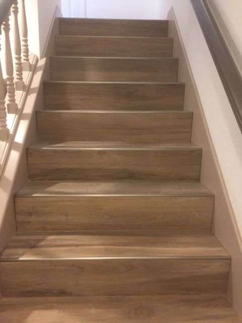 Our Aequa Series Woodlookporcelain Tile Offers A 12x48 Plank Size Perfect For Stairs Https Arizonat Tiled Staircase Porcelain Wood Tile Wood Tile Floors