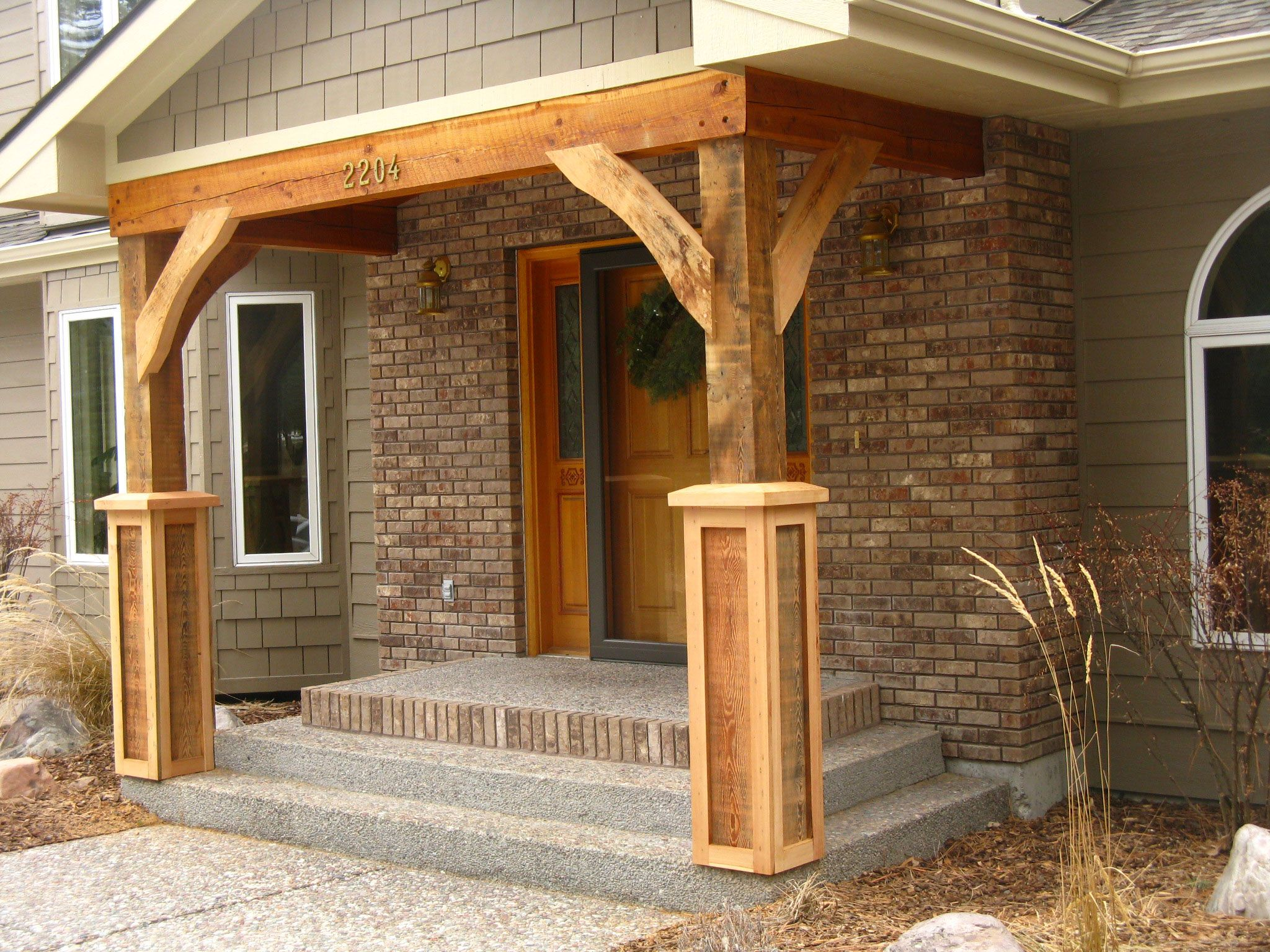 Front porch posts on pinterest front porch posts timber for Wooden house exterior design