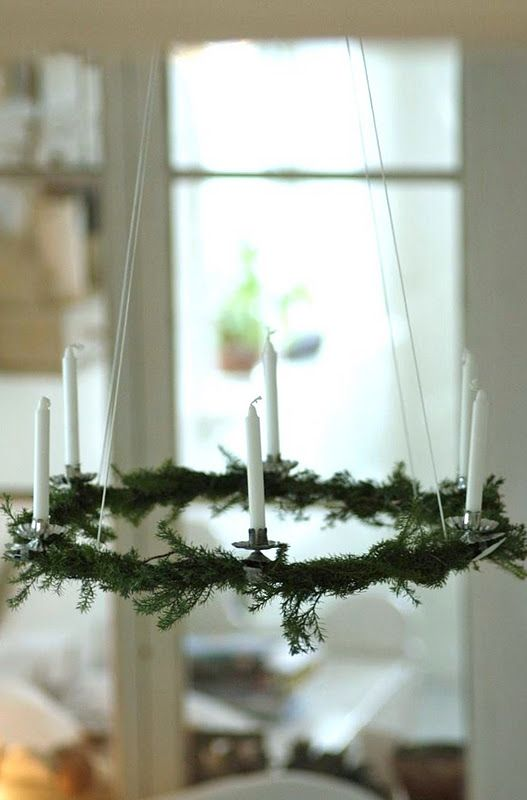 Hanging Advent Candles decorated with pine tree branches