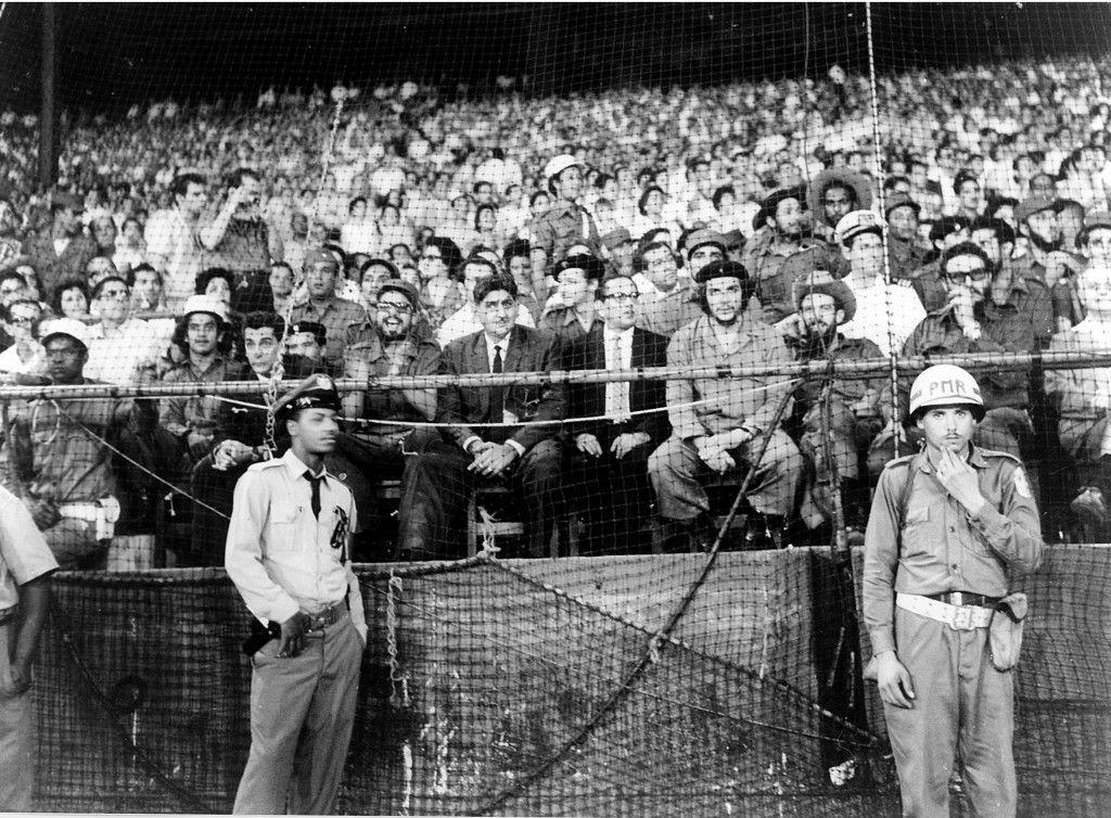 What a posse taking in a Havana ballgame: (Che' Guevera (1928-1967) with beret); to his left is Raul Castro, to Che's right is baseball player and revolutionary hero Camilo Cienfuegos (1932-1959), Fidel Castro is to the right of Cienfuegos