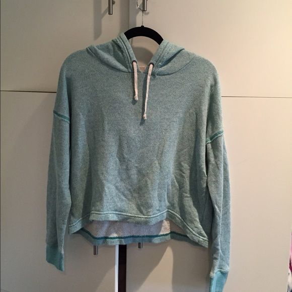 Light blue cropped hoodie Light washed out blue cropped hoodie! Good condition Sweaters