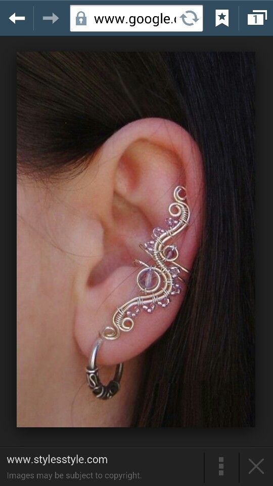 Cool ear cuff... I might just try my hand at this...