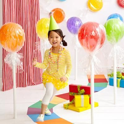 Large lollipops made from balloons, cellophane, and cardboard tubes. To help them stand up they suggest gluing to the floor? Hmmm, cute ideas, but gotta come up with a better way of standing them up. ~Cheryl Charming