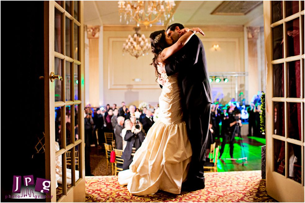www.jpgphotography.com    The newlyweds going in for a kiss at their wedding reception