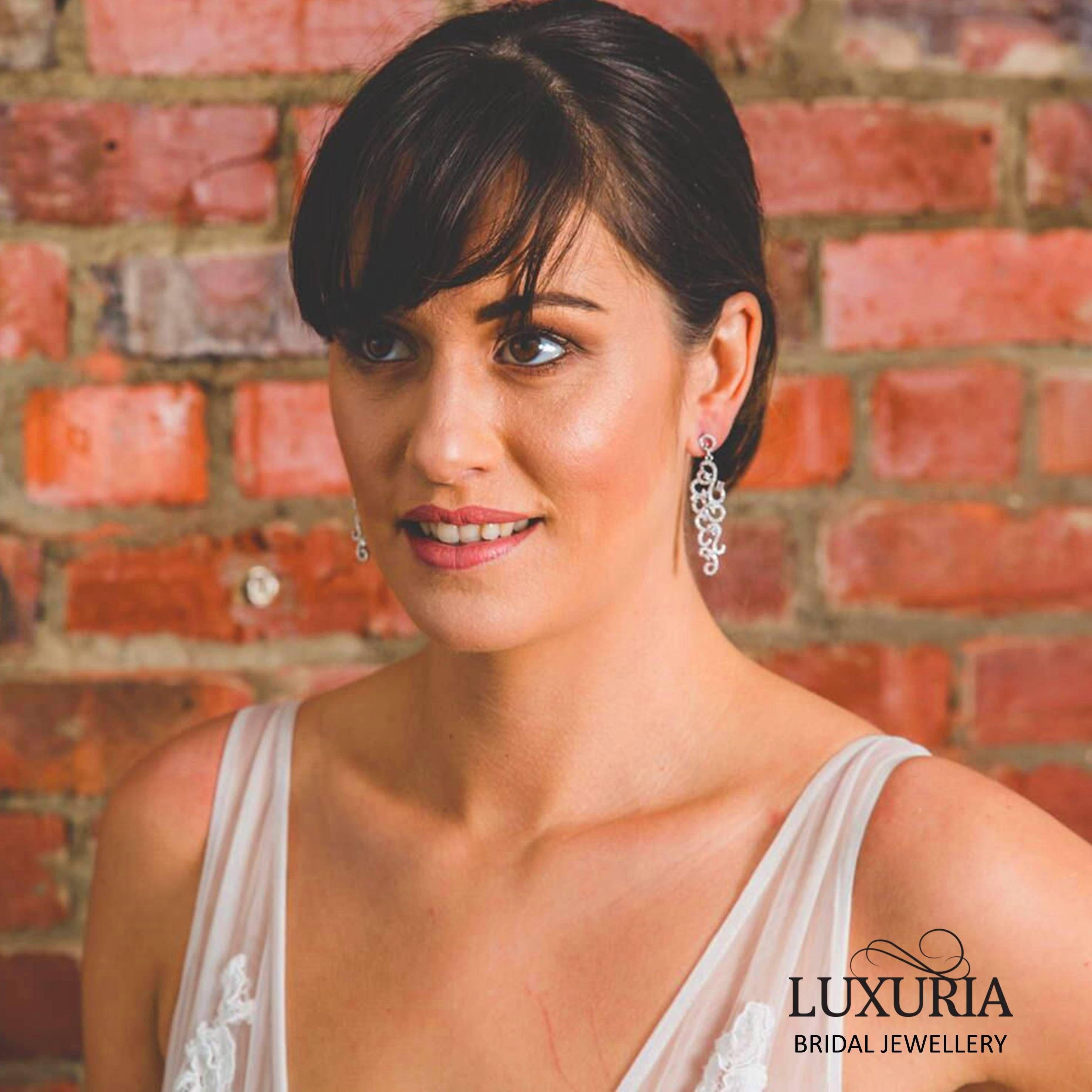 Bride / bridal earrings, long drop with ornate detailing.  Wholesale sterling silver NZ.  Luxuria.  Make up tips brown eyes, pale skin