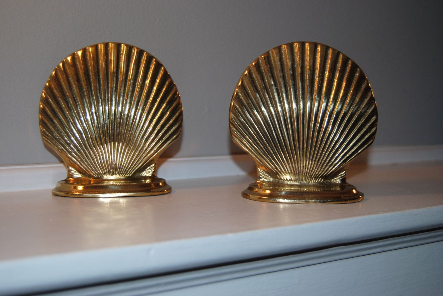 Brass Shell Bookends by TheHouseSouth on Etsy https://www.etsy.com/listing/469717659/brass-shell-bookends