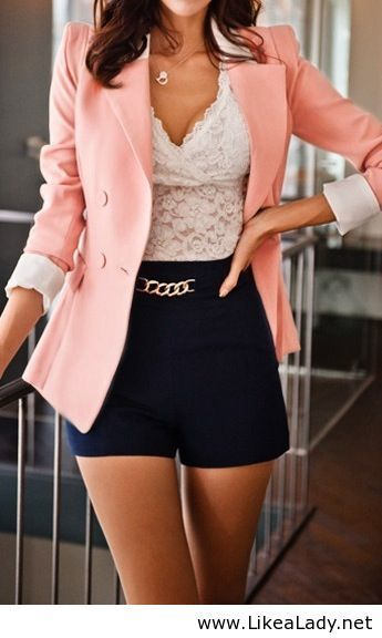 midnight blue shorts with chain accent wh lace top and peach blazer