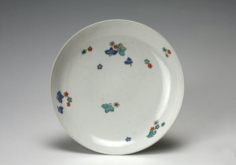 with flowers and leaves Place of Origin Japan Date 1700-1720 Materials Porcelain with enamels Style or Ware Arita ware Kakiemon type Dimensions Diam. & with flowers and leaves Place of Origin: Japan Date: 1700-1720 ...