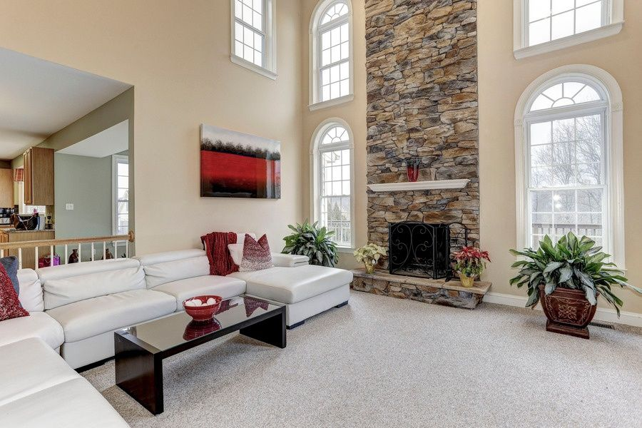 Transitional Living Room With Metal Fireplace Stone Fireplace Carpet Arched Window High