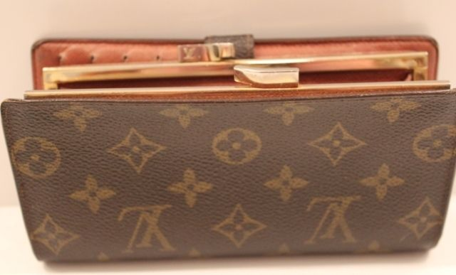 This gorgeous Louis Vuitton wallet features the double LV clasp coin purse, holds up to 6 credit cards, an ID holder, and a place for currency.  It has the traditional monogram LV leather.   www.handbagconsignmentshop.com