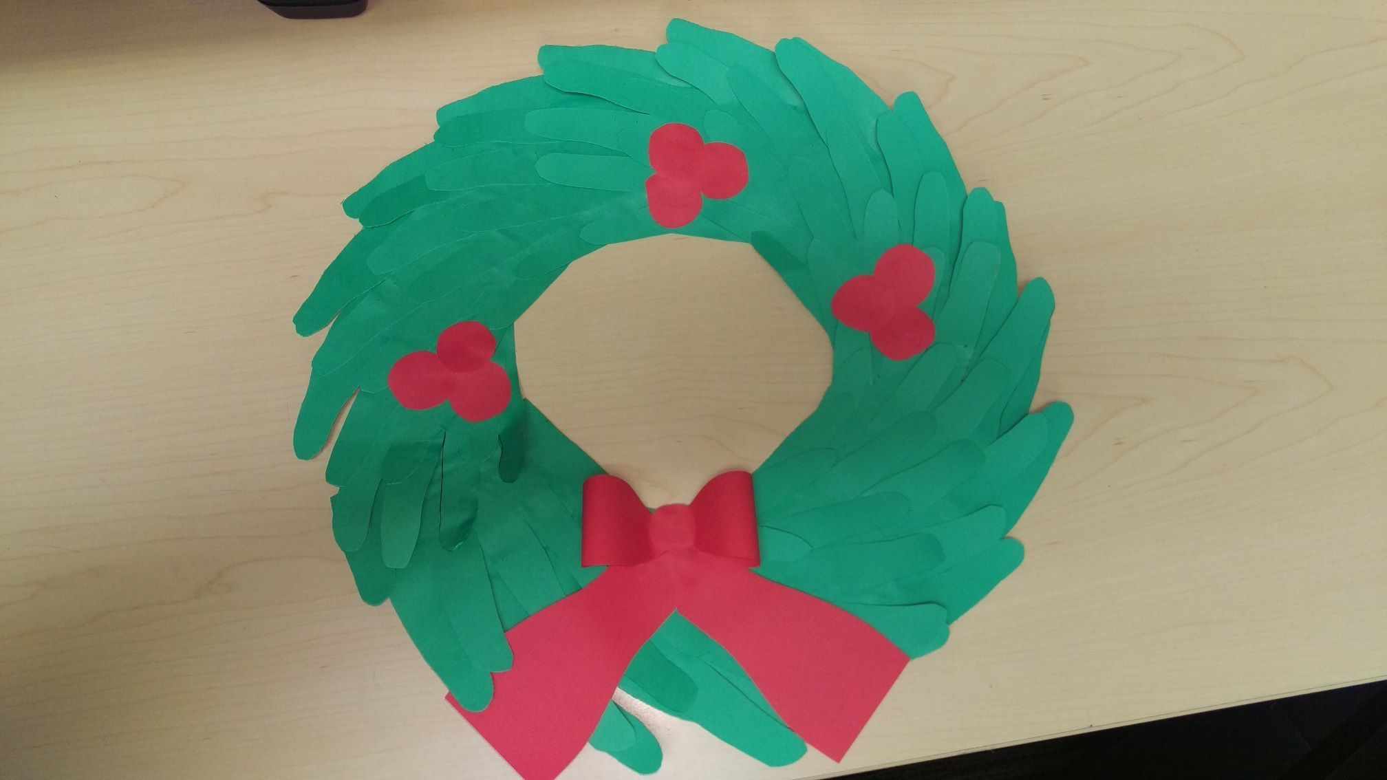 Christmas wreath made of hands The base is a cardboard ring cut out