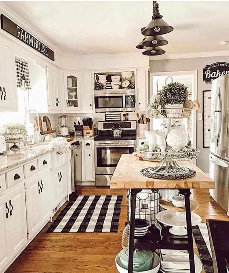 Love the white and black hardware. Kitchen
