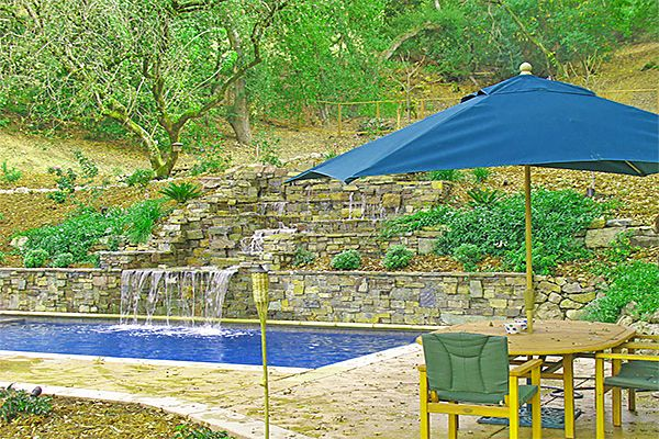 How to build a terraced stone planter how to build a for Pool design hillside