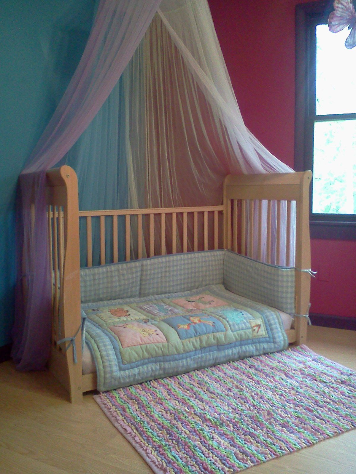 Refurbished crib cut the legs A great idea and McKinley loves it