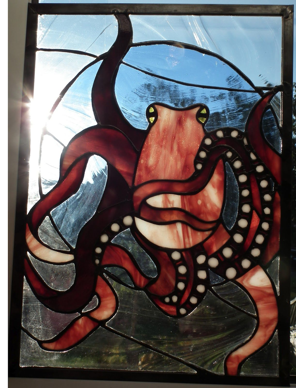 sun shining through stained glass octopus by maria mcmahon