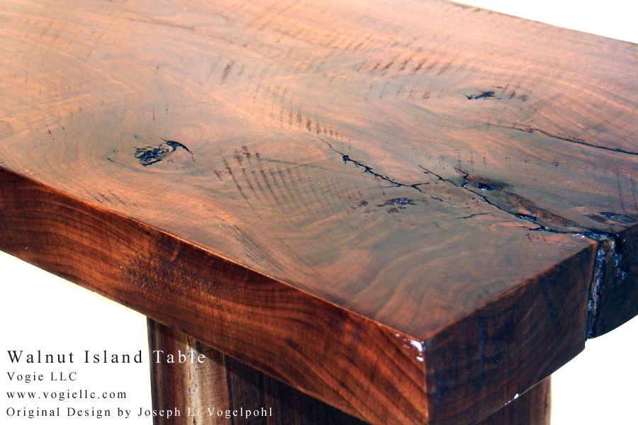 The Walnut Island is a dining table prised of large slabs