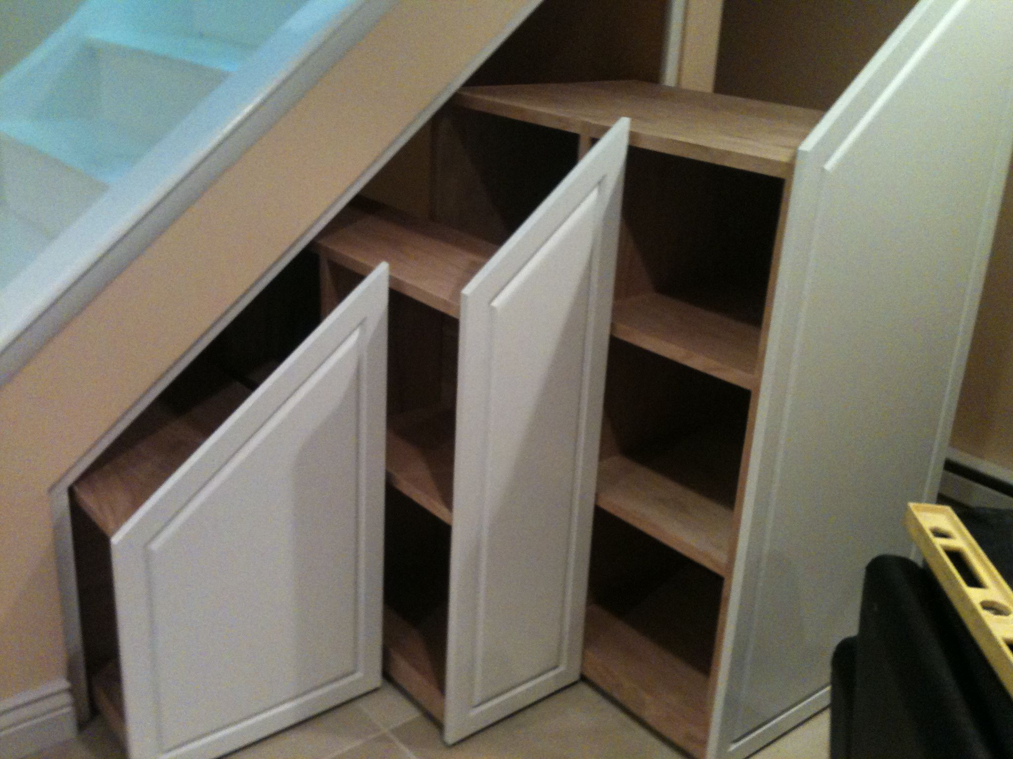 Images of storage under stairs for more wood products for Under the stairs cabinet