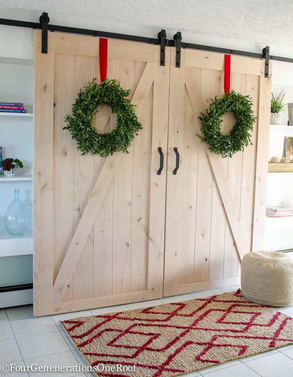 our christmas kitchen 2015 boxwood wreaths red velvet ribbon boxwood christmas tree red striped hand towel greens and holly berry