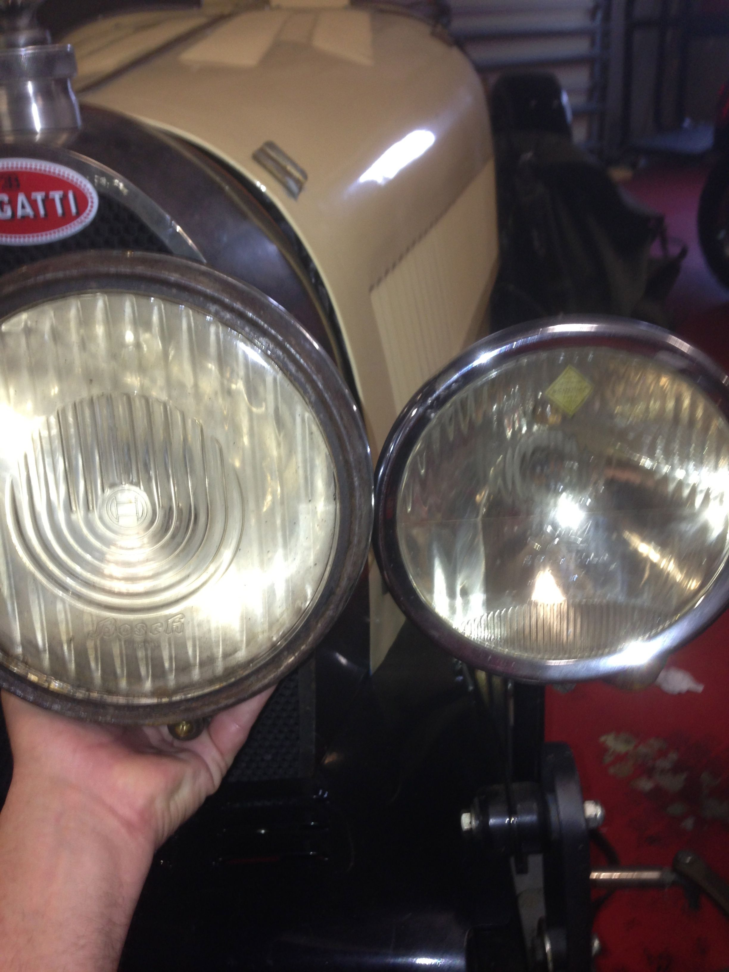 Size parison next to a Scintilla headlamp on a Bugatti of an