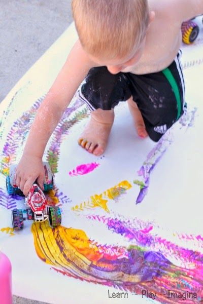 Painting with trucks - fun exploratory art for toddlers! #creativeartsfor2-3yearolds