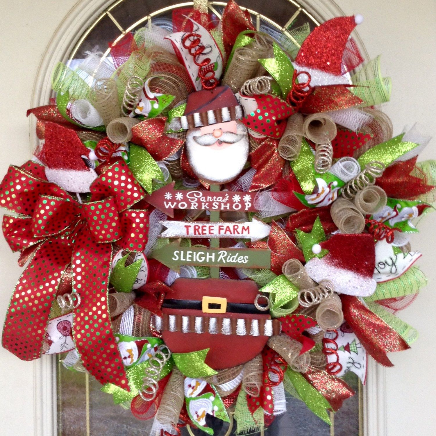 Red green and white Christmas deco mesh wreath with metal Santa