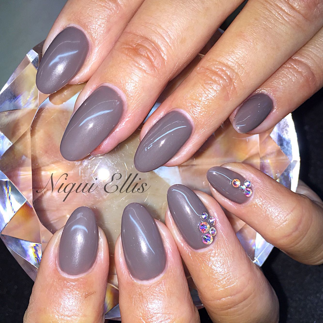 Acrylic nails with gel polish. Jewels added for detail on