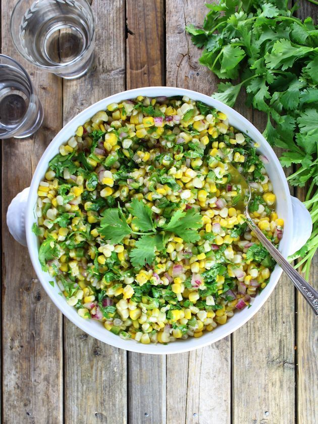 Jalapeño Cilantro Corn Salad - with fresh corn off the cob, red onion, jalapeños & cilantro. Fresh, sweet and flavorful… It's sunshine in a bowl! #corn http://tasteandsee.com