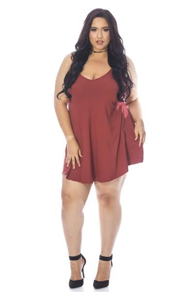 A carefree solid spaghetti strap shift dress made of peach skin soft fabric. This dress features a fitted bodice with a loose flowing A line dress. Looks great
