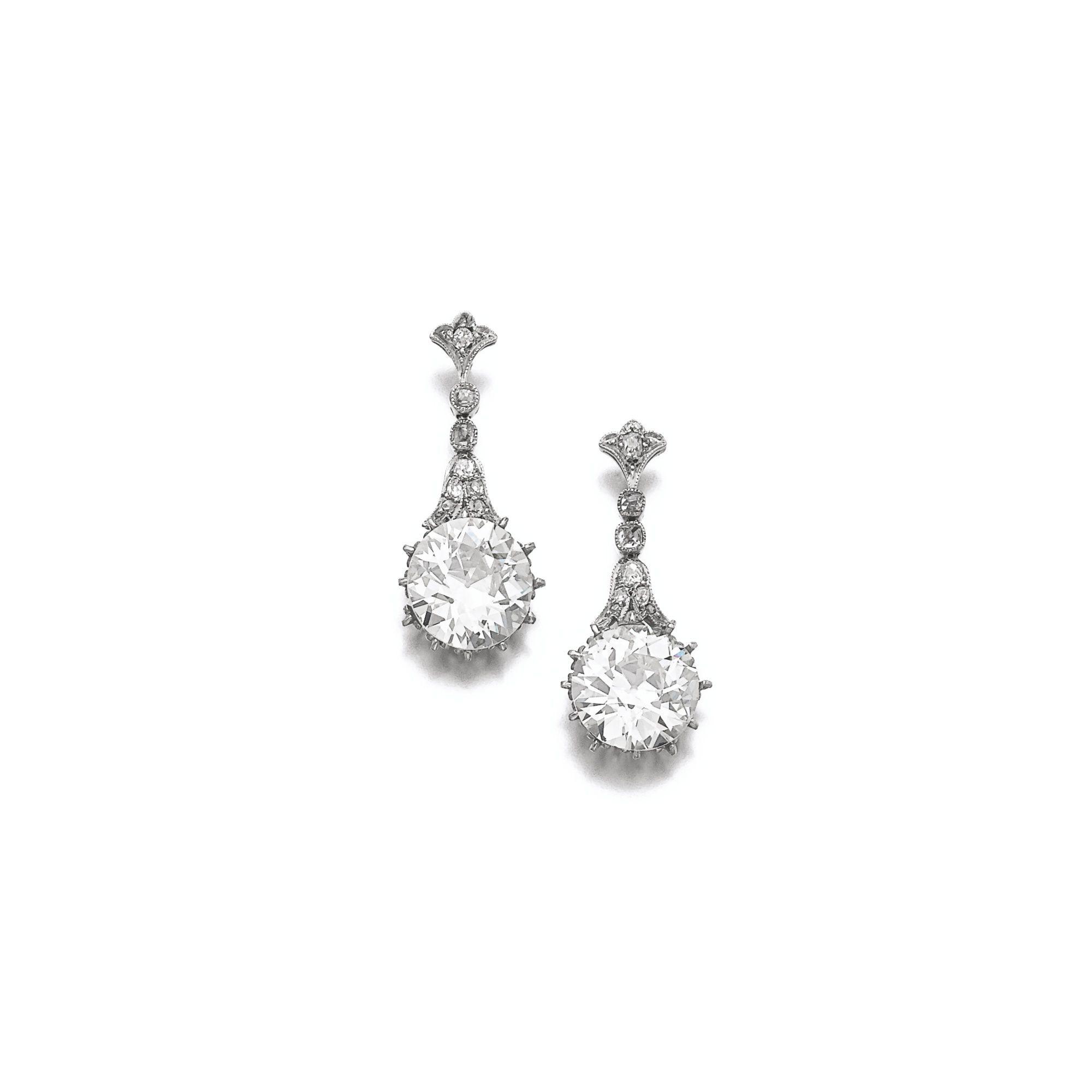 Pair of diamond pendent earrings Each surmount set with cushion