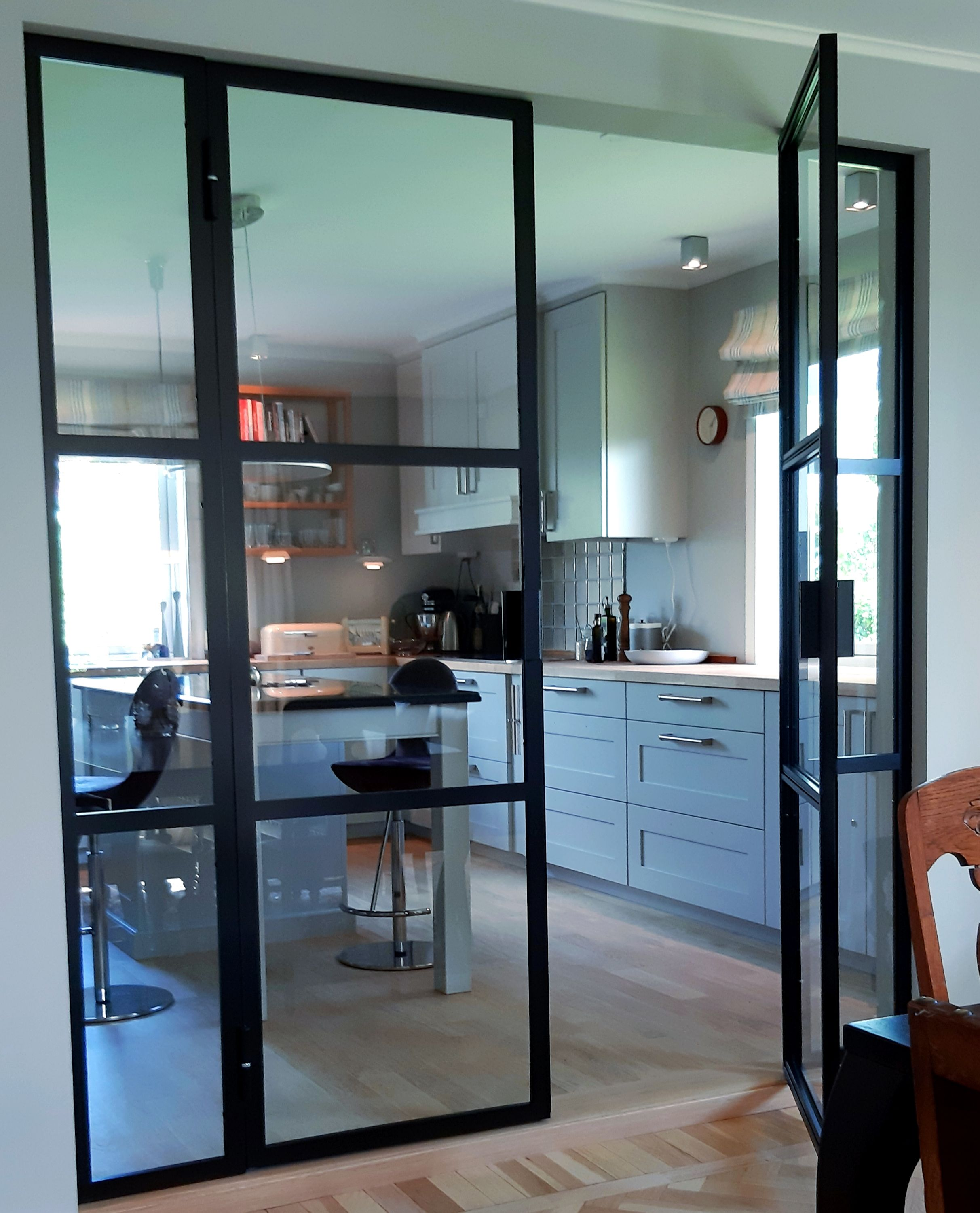 Double french doors with fixed sidefields installed in happy…