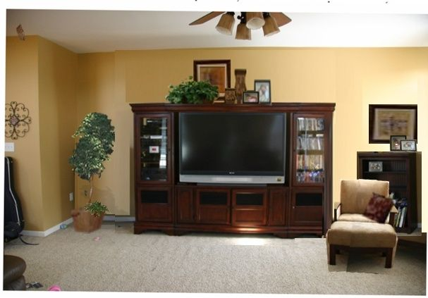 decorating an entertainment center | decorating top of ...