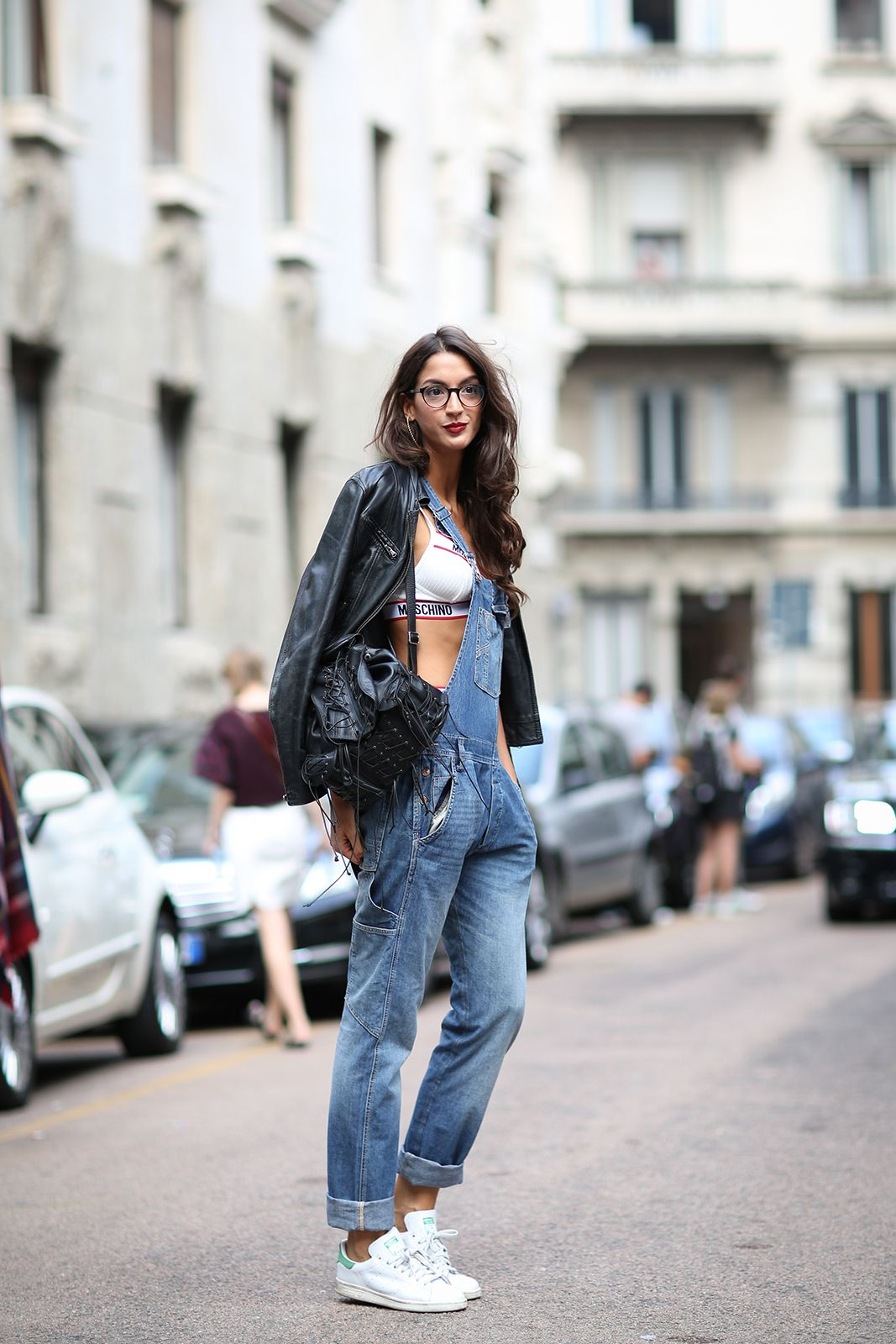How To Dress Like An Italian Girl — 50+ Lessons Worth Knowing #refinery29  http://www.refinery29.com/2014/09/74945/milan-fashion-week-2014-street-style#slide14  Here's the tomboy way to do overalls (though, the glamor waves and lipstick totally crank this look up a notch).