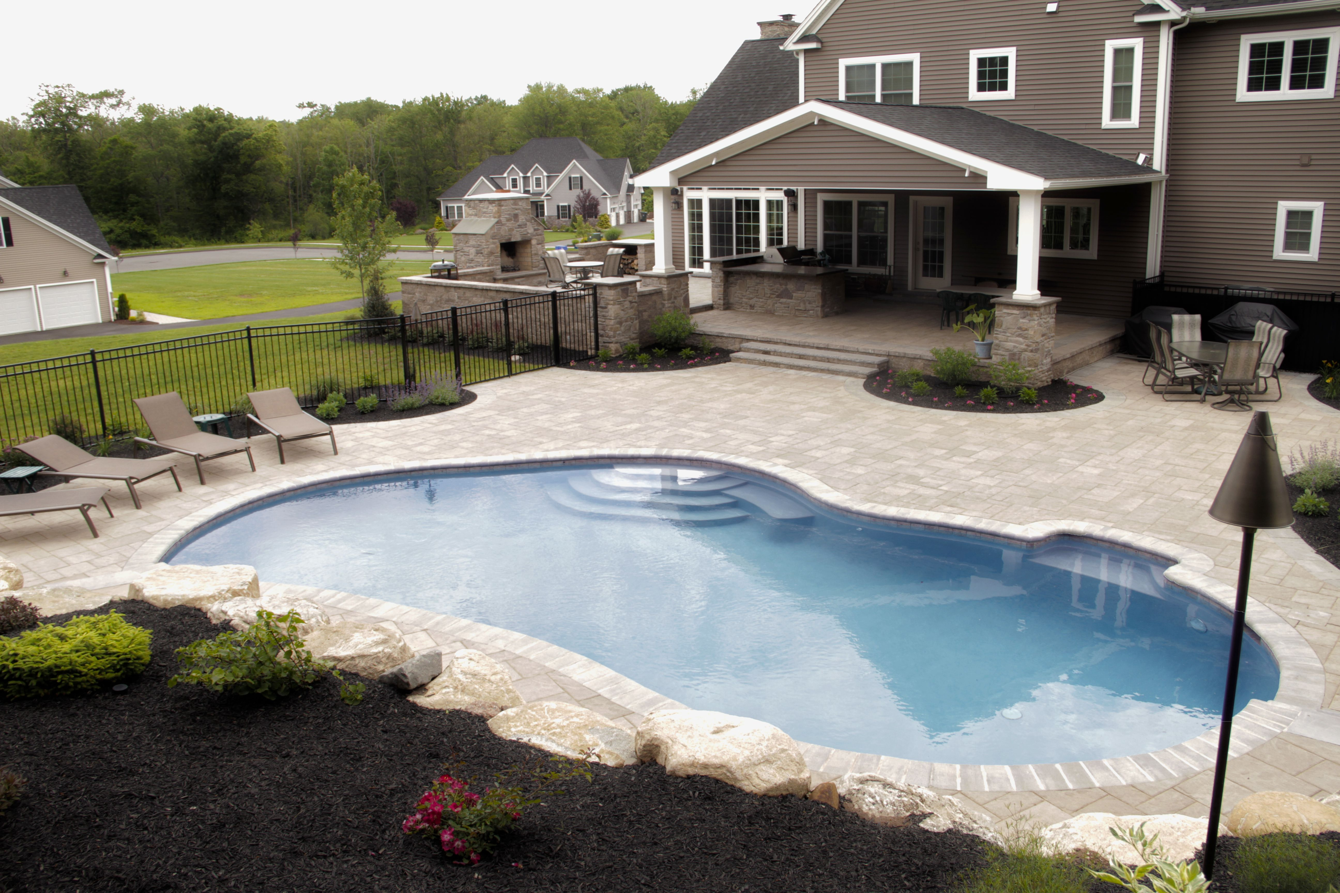Charming This Gorgeous Pool Deck And Patio Define True Outdoor Rooms With Covered  Kitchen, Living Room