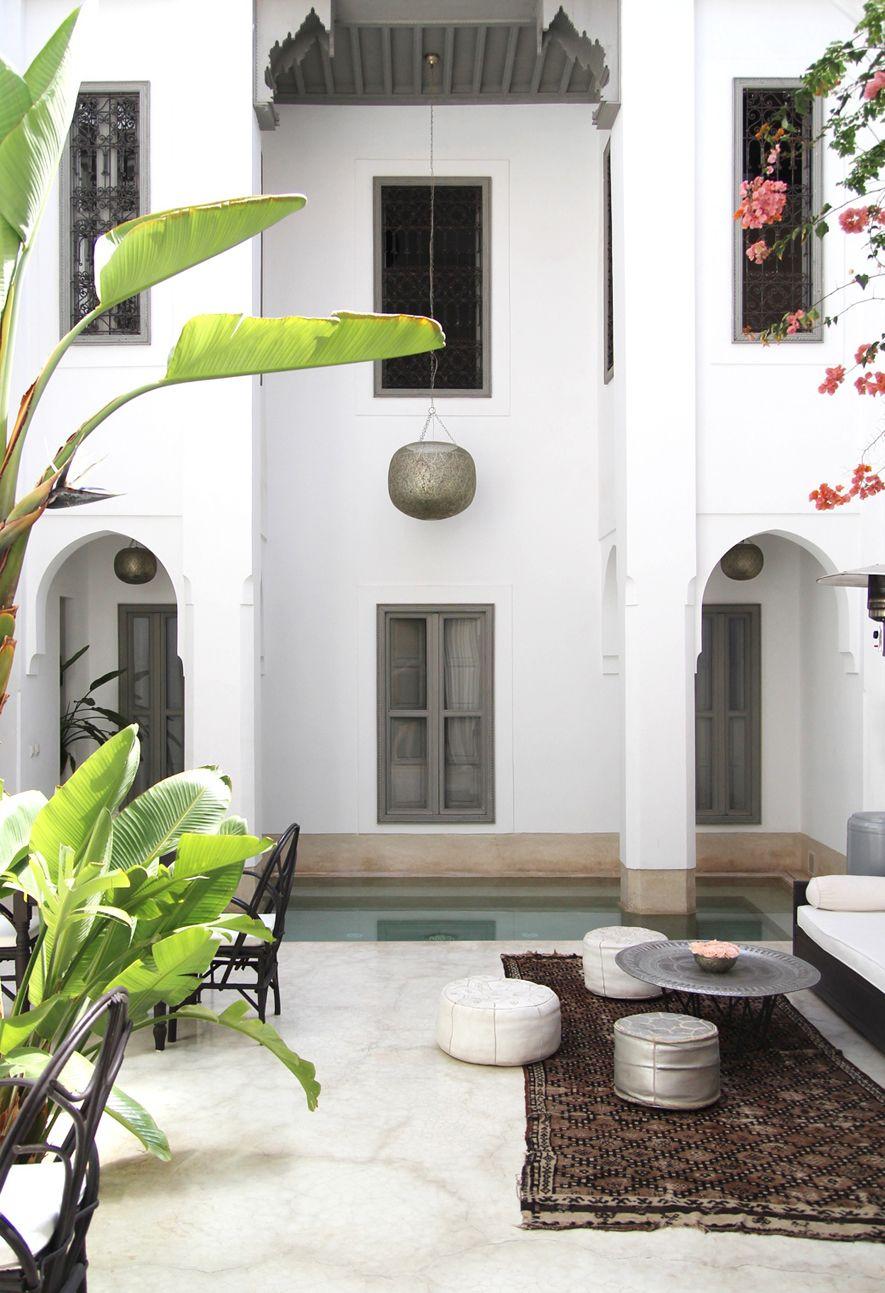 Modern Arabian Exterior: Arched doorways, clean lines, plaster walls ...