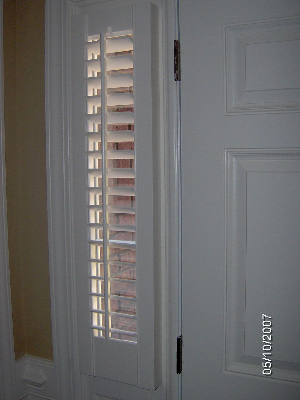 Wood shutters for window sidelight on door plantation for Wood doors and shutters