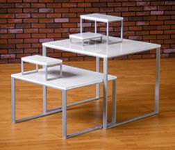 Beautiful White Retail Display Tables With Matte Silver Frames From Melvinroos.com