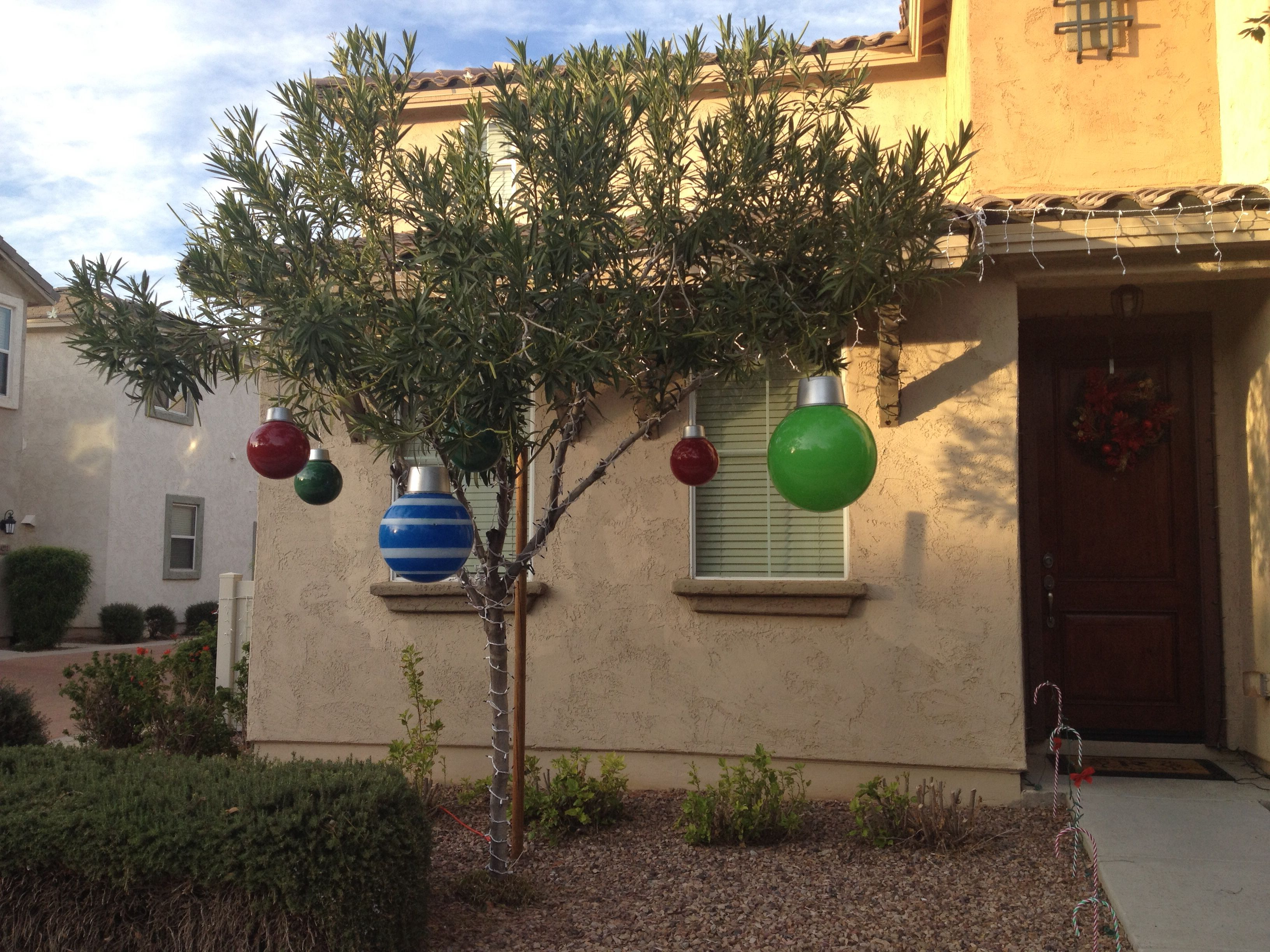Giant Christmas ornaments made from bouncy balls and spray painted