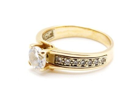 Gold diamond engagement ring with diamond band