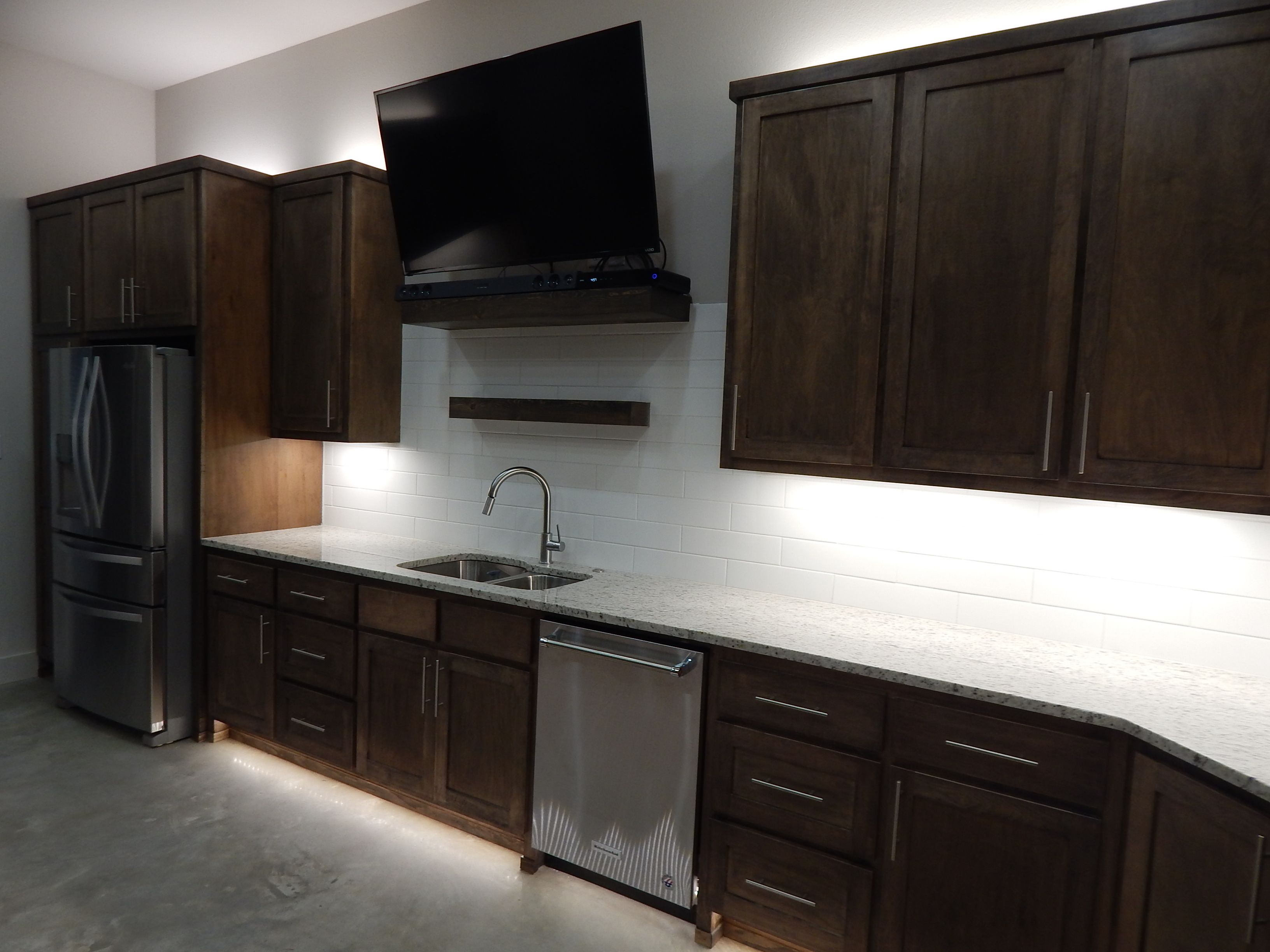 all switches & outlets hidden under cabinets to give subway tile backsplash a clean look